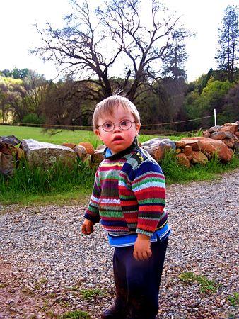 Little boy standing in yard