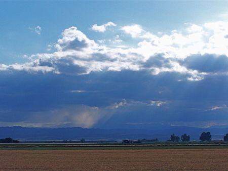 Sun and rain on farm land photo
