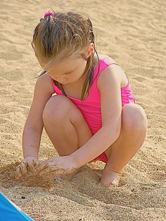 Young girl playing in sand