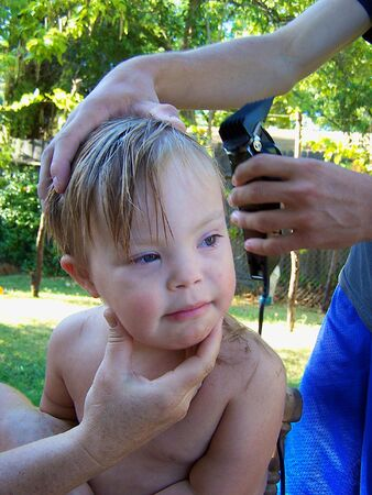 Little boy getting a haircut Stock Photo