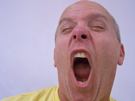 a man yawning photo