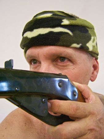 man with camouflage bandana and gun Stock Photo