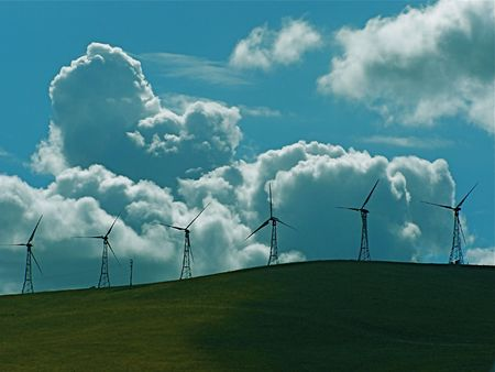 turbines with large clouds Stock Photo