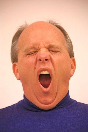 ennui: Man yawning