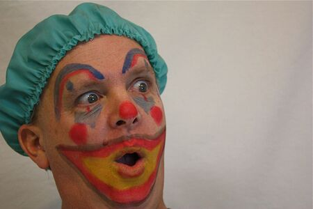 Man with clown face Stock Photo