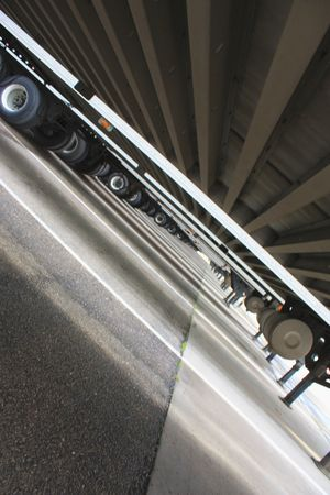 Tilted view under semi-trailers Stock Photo