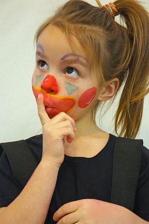 Ni�a con la cara pintada Foto de archivo - 4472959