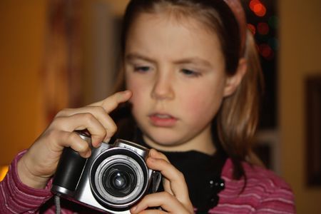 Girl taking a photograph Stock Photo - 4980542