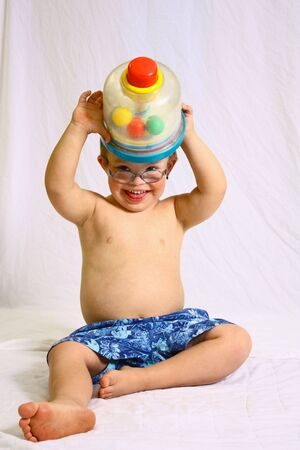 baby playing toy: Little boy with toy  Stock Photo