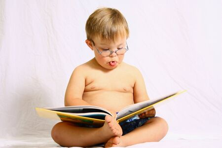 funny glasses: Little boy reading book Stock Photo