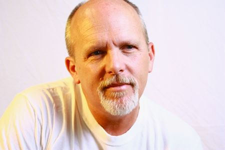 man with a goatee: Bald man with goatee Stock Photo