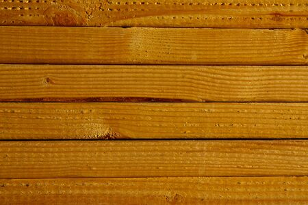 Close-up of grain on stacked lumber photo