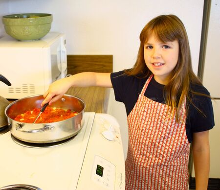 Little girl cooking photo