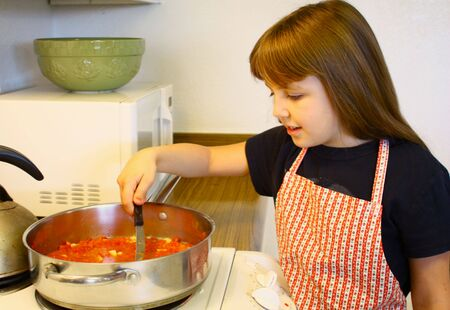 Little girl cooking Banco de Imagens