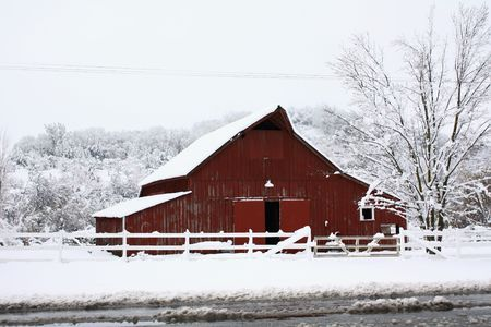 winter road: Big red barn in the snow Stock Photo