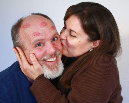 Woman kissing man photo