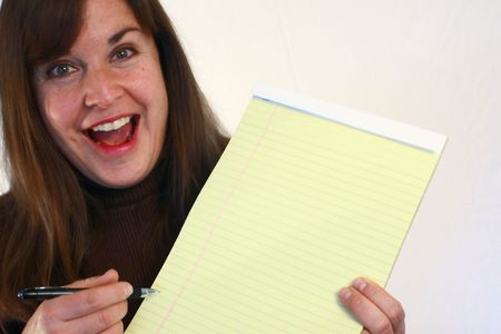 Woman holding notepad photo