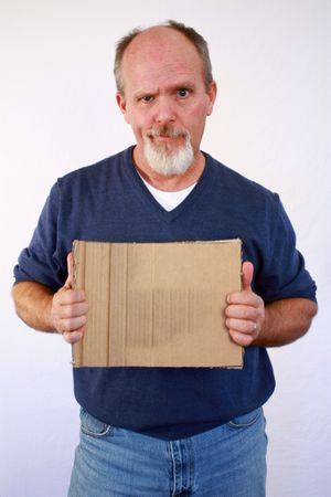 Man holding up square blank piece of cardboard