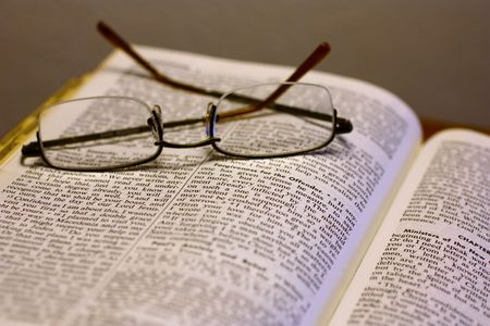 Open Bible with reading glasses photo
