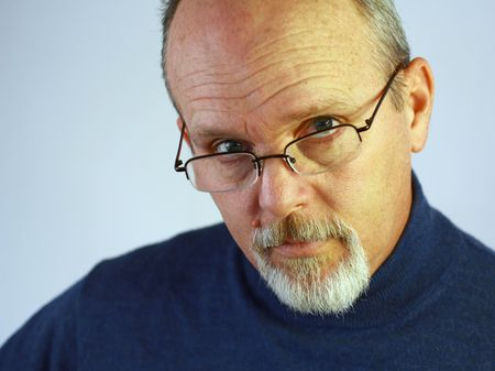 Man with glasses and goatee Stock Photo