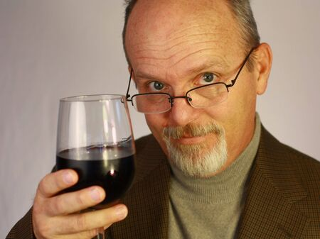 Man with glass of wine photo
