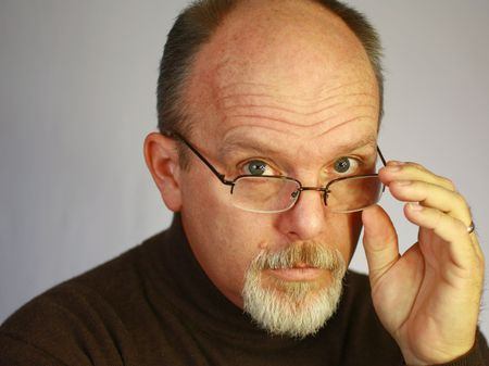 goatee: Bald man with glasses