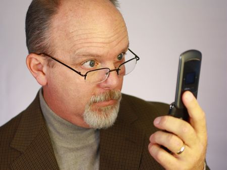 Man looking at cell phone photo