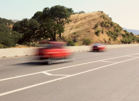 Red vehicles passing by on highway Stock Photo - 7180362
