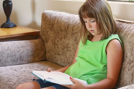 Young girl reading Stock Photo - 7453639