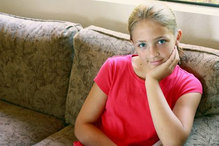 Girl sitting on couch Stock Photo - 7453524