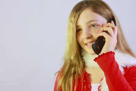 Young girl using a cell phone Stock Photo - 8610160