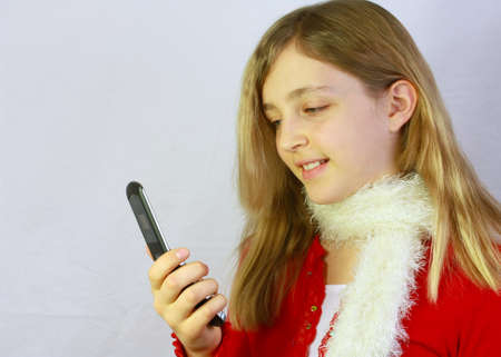 Young girl looking at cellphone photo