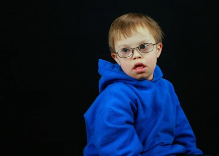 downs syndrome: Little boy with Downs Syndrome   Stock Photo