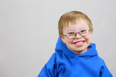 syndrome: Little boy with Downs Syndrome and very happy smile Stock Photo