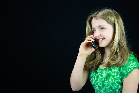 Young girl using a cell phone Stock Photo - 9741181