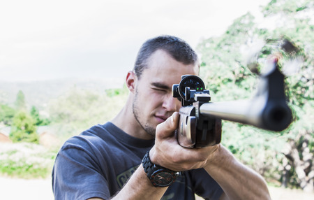 aiming: Man with Rifle Stock Photo