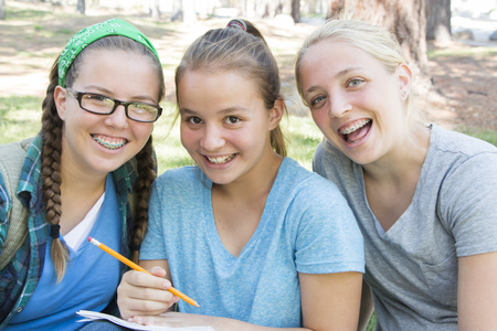 oudoor: Young Girls Studying at the Park