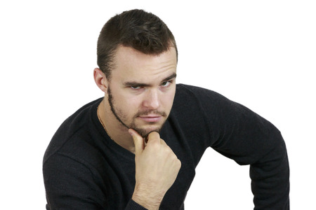 hand on the chin: Young Man With Hand on Chin on White Background