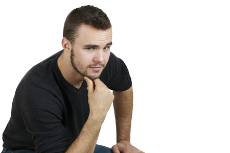 hand on the chin: Young Man With Hand on Chin on White Background Background Stock Photo