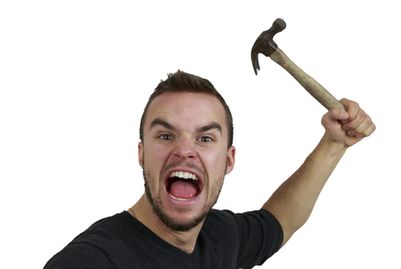 outrage: Angry Man With Hammer Up in Hand Stock Photo