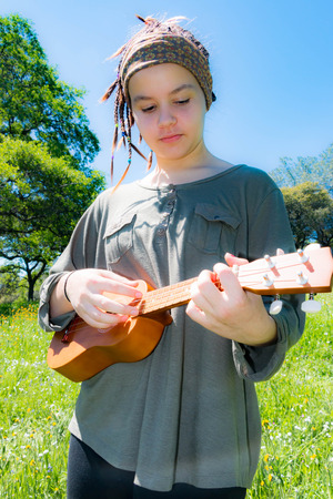 Cute Young Girl With Ukulele Under Sunlight Sky