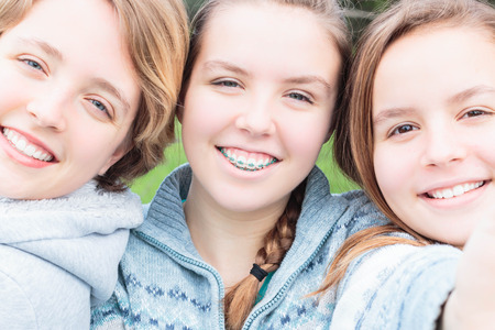 Three Cute Girls Taking a Selfie together Stock Photo