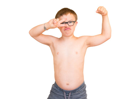 Young Boy With Downs Syndrome Flexing His Muscles