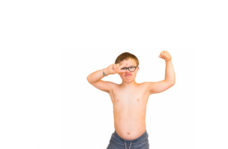 litle: Young Boy With Downs Syndrome Flexing His Muscles