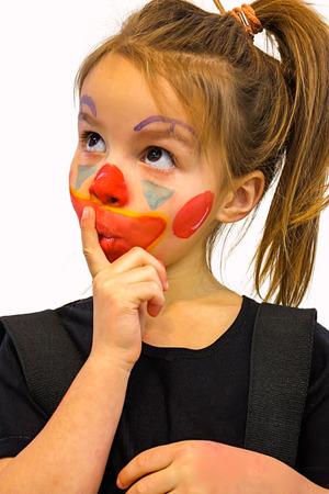 Beautiful Little Girl With Clown Makeup photo