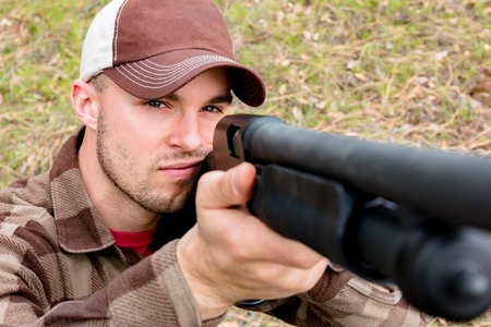 outside shooting: Young Man Hunting With Shotgun