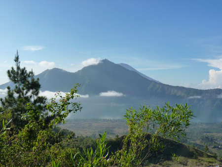Beautiful sunrise on the volcano. View of Agung volcano from the peak of Mount Batur. Indonesia, Bali.