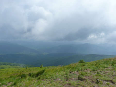 Foggy mountains forest and meadow. Beautiful landscape moody clouds rainy weather scenic background colors. Bieszczady mountains, Poland Stock Photo