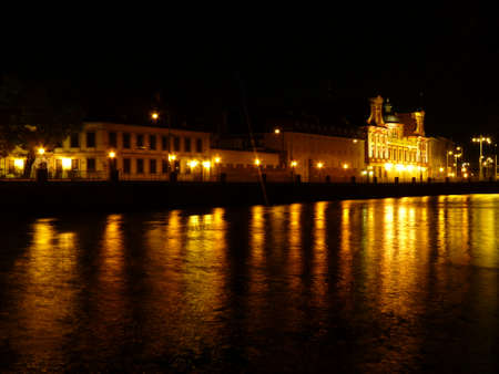 Wroclaw at night. Beautifully lit buildings reflecting in the Odra river. poland
