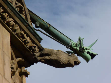 Gargoyle on the roof of a medieval building
